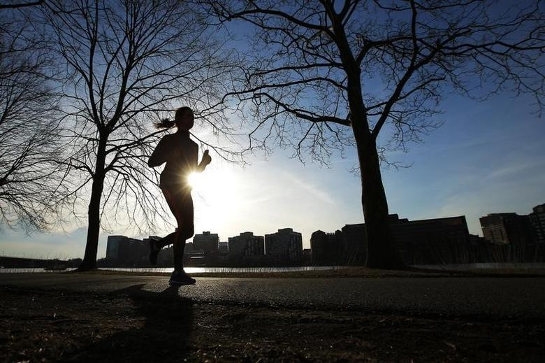 A woman jogs along the Charles River on an early spring evening in Boston, Massachusetts April 3, 2014. REUTERS/Brian Snyder