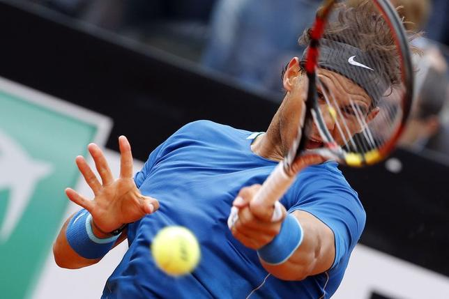 Rafael Nadal of Spain hits a return to Novak Djokovic of Serbia during their men's singles final match at the Rome Masters tennis tournament May 18, 2014. REUTERS/Giampiero Sposito