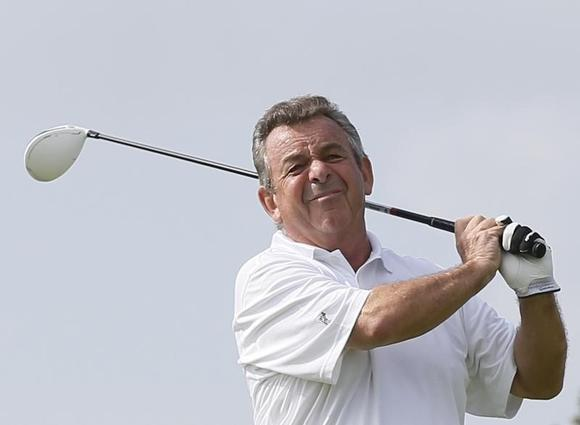 Tony Jacklin of England tees off on the first hole during the first round of the Mission Hills World Celebrity Pro-Am golf tournament in Haikou, China's Hainan province October 20, 2012. REUTERS/Tyrone Siu/Files