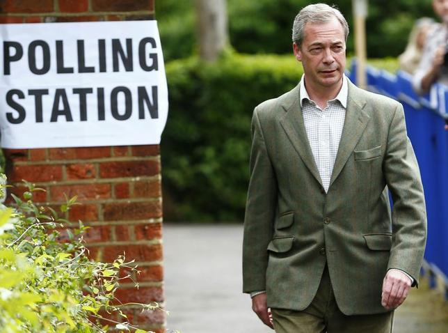 Nigel Farage, the leader of Britain's United Kingdom Independence Party (UKIP) arrives to vote in local and European elections at a polling station in Biggin Hill on the outskirts of London May 22, 2014. REUTERS/Andrew Winning