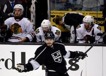 May 24, 2014; Los Angeles, CA, USA; Los Angeles Kings defenseman Drew Doughty (8) celebrates in front of the Chicago Blackhawks bench after scoring a goal during the third period in game three of the Western Conference Final of the 2014 Stanley Cup Playoffs at Staples Center. Mandatory Credit: Richard Mackson-USA TODAY Sports