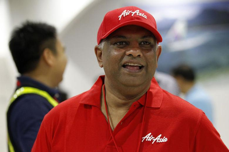 Tony Fernandes, CEO of AirAsia, looks on upon arrival at the domestic airport in Manila May 23, 2014. REUTERS/Romeo Ranoco