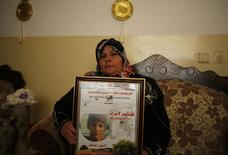 Feryal, the mother of 16-year-old Mohammed Suleiman, holds his picture at her house in the West Bank village of Hares near Salfit  May 12, 2014.   REUTERS/Mohamad Torokman