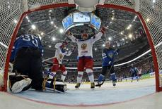 Russia's Yegor Yakovlev (C) celebrates a goal against Finland as goalie Pekka Rinne (L) reacts during their men's ice hockey World Championship final game at Minsk Arena in Minsk May 25, 2014.      REUTERS/Grigory Sokolov/Pool