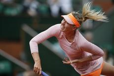 Maria Sharapova of Russia serves to compatriot Ksenia Pervak during their women's singles match at the French Open tennis tournament at the Roland Garros stadium in Paris May 26, 2014.       REUTERS/Gonzalo Fuentes