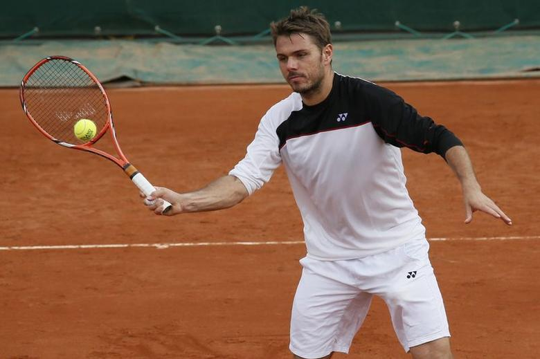 Stan Wawrinka of Switzerland practices during a training session for the French Open tennis tournament at the Roland Garros stadium in Paris May 24, 2014. REUTERS/Gonzalo Fuentes