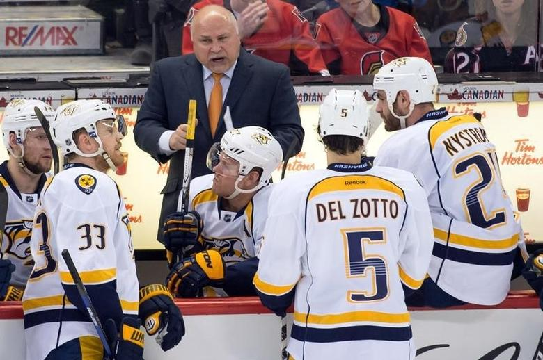 Mar 10, 2014; Ottawa, Ontario, CAN; Nashville Predators Head Coach Barry Trotz speaks to his team during a timeout in the third period against the Ottawa Senators at the Canadian Tire Centre. Marc DesRosiers-USA TODAY Sports - RTR3GINP