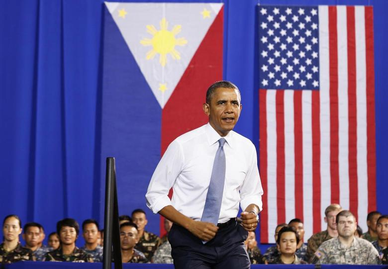 U.S. President Barack Obama walks out to speak to military troops at the Fort Bonifacio Gymnasium in Manila, April 29, 2014. REUTERS/Larry Downing