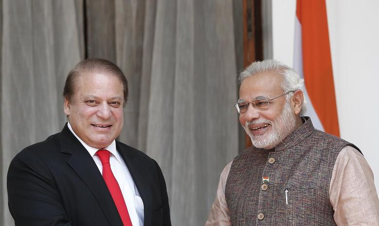 Prime Minister Narendra Modi (R) and his Pakistani counterpart Nawaz Sharif smile before the start of their bilateral meeting in New Delhi May 27, 2014. REUTERS/Adnan Abidi