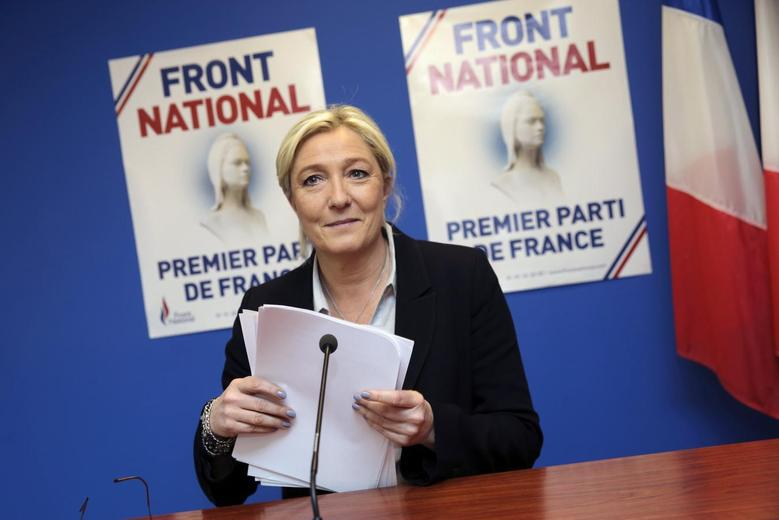Marine Le Pen, France's National Front political party head, arrives at a news conference at the party's headquarters in Nanterre, near Paris, May 27, 2014.  REUTERS/Philippe Wojazer