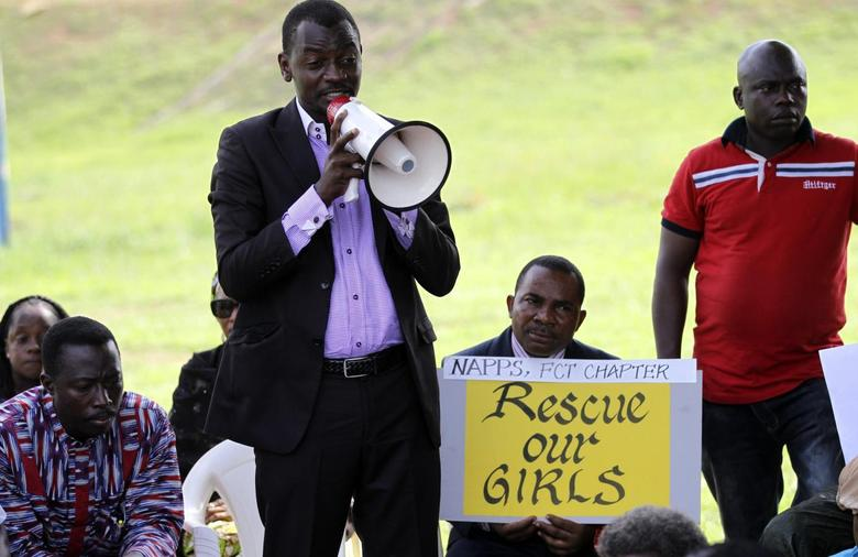 A protester addresses a sit-in rally in support of the release of the abducted Chibok schoolgirls, at the Unity Fountain in Abuja May 15, 2014.  REUTERS/Afolabi Sotunde