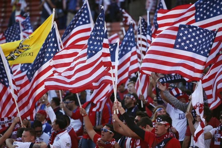 Fans of the U.S. wave their U.S. national flags before an international friendly soccer match against Azerbaijan in San Francisco, California May 27, 2014. REUTERS/Stephen Lam