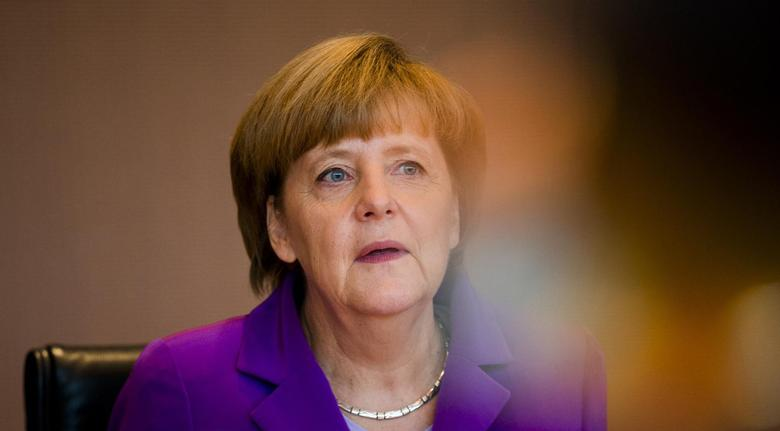 German Chancellor Angela Merkel attends a cabinet meeting at the Chancellery in Berlin May 28, 2014.  REUTERS/Thomas Peter
