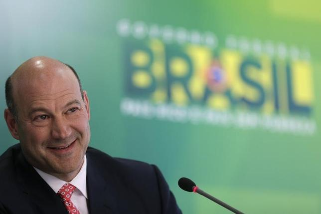 Gary Cohn, president and COO of Goldman Sachs, speaks during news conference after a meeting with Brazil's President Dilma Rousseff in Brasilia April 9, 2014. REUTERS/Ueslei Marcelino