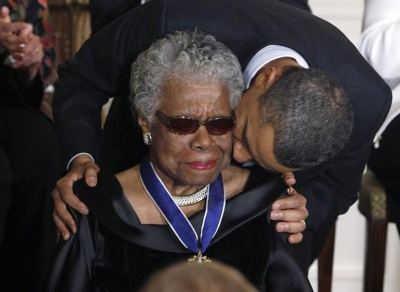 Maya Angelou receives a Medal of Freedom from U.S. President Barack Obama at the White House in Washington, February 15, 2011. REUTERS/Larry Downing/Files