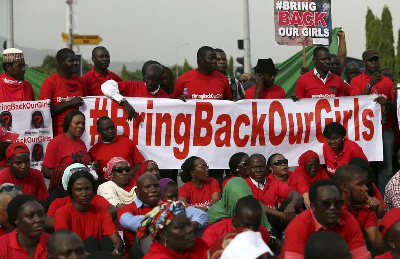 The Abuja wing of the ''Bring Back Our Girls'' protest group prepare to march to the presidential villa to deliver a protest letter to Nigeria's President Goodluck Jonathan in Abuja, calling for the release of the Nigerian schoolgirls in Chibok who were kidnapped by Islamist militant group Boko Haram, May 22, 2014. REUTERS/Afolabi Sotunde