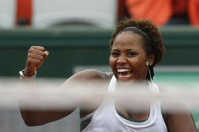 Taylor Townsend of the U.S celebrates after winning her women's singles match against Alize Cornet of France at the French Open tennis tournament at the Roland Garros stadium in Paris May 28, 2014. REUTERS/Jean-Paul Pelissier