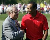 Tiger Woods of the U.S. is congratulated by Jack Nicklaus (L) after his final round of the Memorial Tournament at Muirfield Village Golf Club in Dublin, Ohio, June 3, 2012.  REUTERS/Matt Sullivan/Files