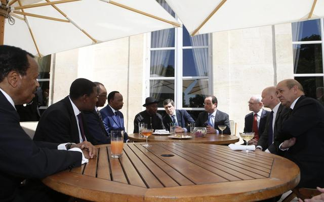Nigerian President Goodluck Jonathan (5th L) attends the African Security Summit at the Elysee Palace in Paris in this May 17, 2014 file photo. From left: Cameroon's President Paul Biya, Benin's President Thomas Yayi Boni, Chad's President Idriss Deby, Niger's President Mahamadou Issoufou, Jonathan, an unidentified man, French President Francois Hollande, European Council President Herman Van Rompuy, Britain's Foreign Secretary William Hague and France's Defence Minister Jean-Yves Le Drian.  REUTERS/Gonzalo Fuentes/Files