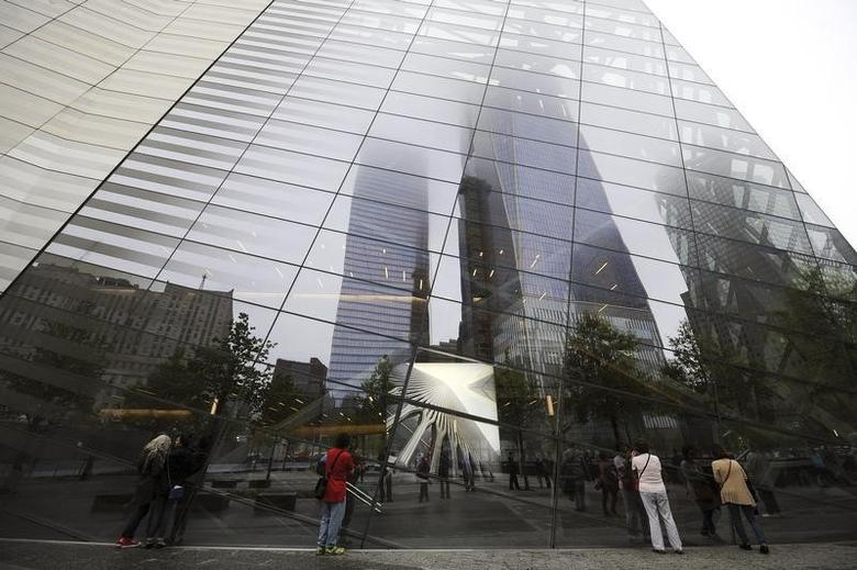 An image of one of the original World Trade Center Towers is displayed in the window of the  9/11 Memorial Museum pavilion during the dedication ceremony at the National September 11 Memorial Museum in New York, May 15, 2014.  REUTERS/ Anthony Behar/Pool