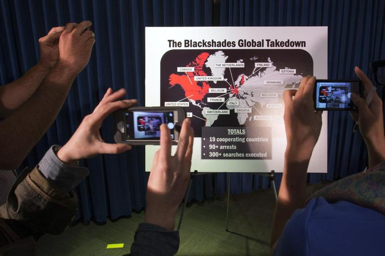 Journalists take photographs of a display referring to ''BlackShades'' malware during a news conference by the U.S. Attorney for the Southern District of New York to announce law enforcement action to target creators and purveyors of malicious computer software, in Lower Manhattan, New York May 19, 2014.  REUTERS/Adrees Latif