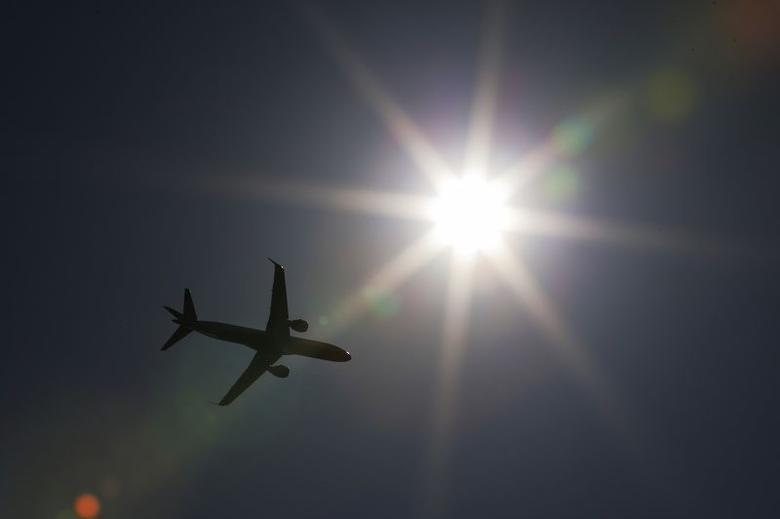 A commercial airliner takes off from Logan airport in Boston, Massachusetts May 12, 2014.    REUTERS/Brian Snyder