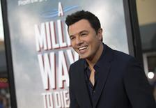 "Director and cast member Seth MacFarlane poses at the premiere of ""A Million Ways to Die in the West"" in Los Angeles, California May 15, 2014. REUTERS/Mario Anzuoni"