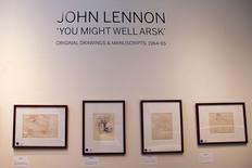 Una serie de dibujos y manuscritos de John Lennon exhibidos por la casa de subastas Sotheby's en Nueva York, mayo 29 2014. Manuscritos originales y dibujos autografiados realizados por el ex 'beatle' John Lennon para dos libros publicados a mediados de la década de 1960 saldrán a la venta en una subasta la próxima semana en Nueva York, dijo Sotheby's. REUTERS/Shannon Stapleton   (UNITED STATES - Tags: ENTERTAINMENT)
