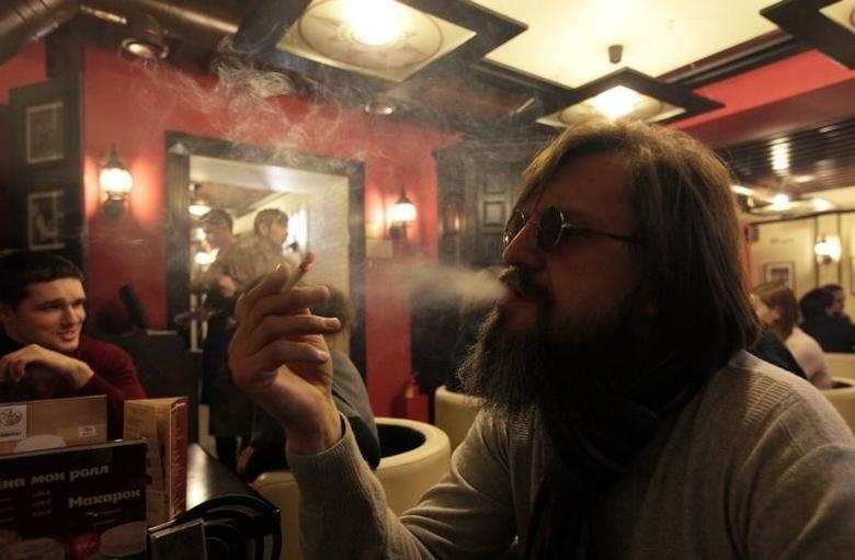 A man smokes a cigarette at a cafe in central Krasnoyarsk in Siberia January 24, 2013.  REUTERS/Ilya Naymushin