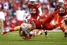 Dec 29, 2013; Phoenix, AZ, USA; San Francisco 49ers wide receiver Quinton Patton (11) is tackled by Arizona Cardinals linebacker Daryl Washington in the second half at University of Phoenix Stadium. The 49ers defeated the Cardinals 23-20. Mandatory Credit: Mark J. Rebilas-USA TODAY Sports