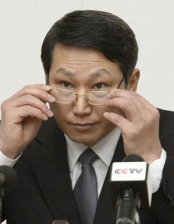 South Korean missionary, identified by the North as Kim Jong Uk, adjusts his glasses during a news conference in Pyongyang in this February 27, 2014 file photo provided by Kyodo. Mandatory credit    REUTERS/Kyodo/Files