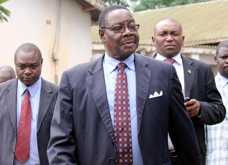 File photo of Peter Mutharika (C), as he leaves the Malawi court in Lilongwe March 14, 2013. REUTERS/Mabvuto Banda