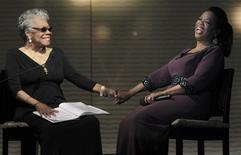"Oprah Winfrey (R) laughs with poet Maya Angelou during the taping of ""Oprah's Surprise Spectacular"" in Chicago May 17, 2011.  REUTERS/John Gress"