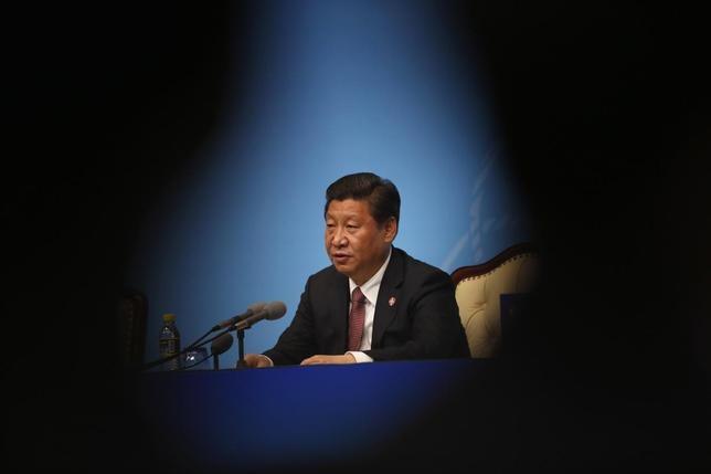 China's President Xi Jinping delivers a speech to the media during the fourth Conference on Interaction and Confidence Building Measures in Asia (CICA) summit, in Shanghai May 21, 2014. REUTERS/Carlos Barria (CHINA - Tags: POLITICS) - RTR3Q5BM