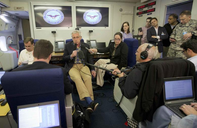 U.S. Defence Secretary Chuck Hagel speaks during his flight abroad a U.S. military aircraft June 1, 2014.  REUTERS/Pablo Martinez Monsivais/Pool