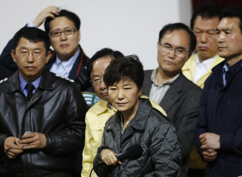 South Korean President Park Geun-hye (C) listens to a family member of a missing passenger who was on South Korean ferry ''Sewol'', which sank at the sea off Jindo, during her visit to a gym where family members gathered, in Jindo April 17, 2014.  REUTERS/Kim Hong-Ji