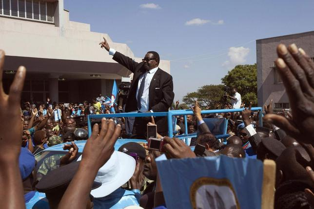 Malawi's President Peter Mutharika of the Democratic Progressive Party waves to supporters after he was sworn in in Blantyre May 31, 2014. REUTERS/Eldson Chagara