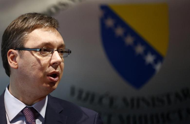 Serbian Prime Minister and the leader of Serbian Progressive Party (SNS) Aleksandar Vucic speaks during a news conference with his Bosnian counterpart Vjekoslav Bevanda (not pictured) in Sarajevo, May 13, 2014. REUTERS/Dado Ruvic