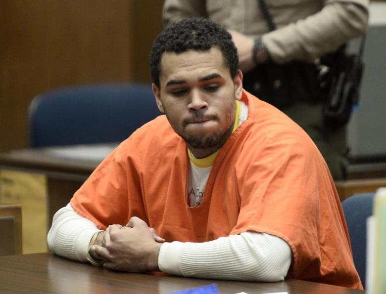 Chris Brown appears in court for a hearing at the Criminal Courts in Los Angeles May 9, 2014. REUTERS/Paul Buck/Pool