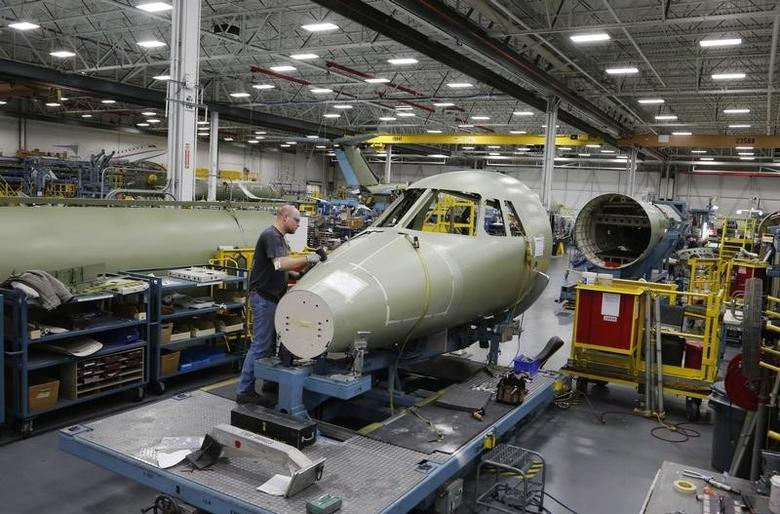 Darrel Frakes works on the jet assembly line in Cessna's manufacturing plant in Wichita, Kansas March 12, 2013. REUTERS/Jeff Tuttle