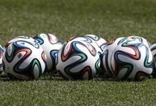 Official 2014 FIFA World Cup Brazil footballs sit on the pitch during a U.S. men's national soccer team training session in Harrison, New Jersey, May 30, 2014. REUTERS/Mike Segar