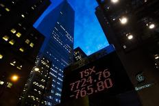 A sign displaying TSX information is seen in Toronto November 20, 2008. REUTERS/Mark Blinch