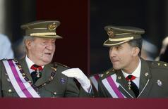 Spain's Crown Prince Felipe listens to his father King Juan Carlos (L) during a ceremony marking the bicentennial of the creation of the order of Saint Hermenegildo at the Monastery of San Lorenzo de El Escorial, outside Madrid June 3, 2014. The king said on Monday he would abdicate in favour of his son Prince Felipe, aiming to revive the scandal-hit monarchy at a time of economic hardship and growing discontent with the wider political elite. REUTERS/Sergio Perez (SPAIN - Tags: ROYALS POLITICS) - RTR3RZ8M
