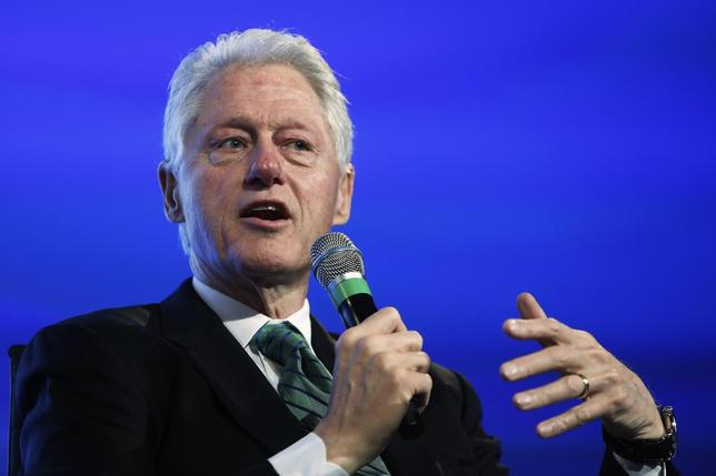 Former U.S. President Bill Clinton speaks during an onstage interview during the 2014 Peterson Foundation Fiscal Summit in Washington May 14, 2014. REUTERS/Jonathan Ernst
