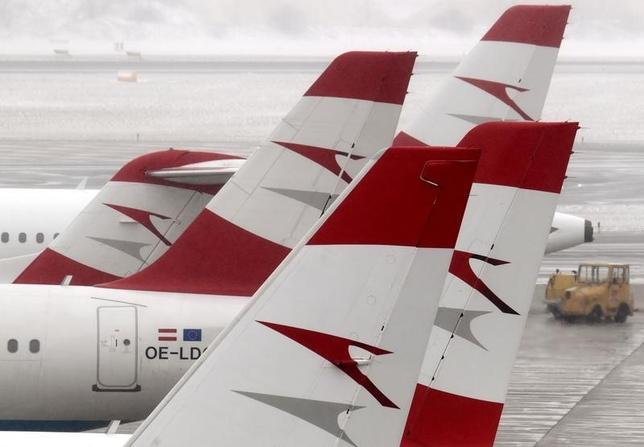 The tails of Austrian Airlines planes are pictured at the airport in Schwechat March 14, 2013. REUTERS/Heinz-Peter Bader