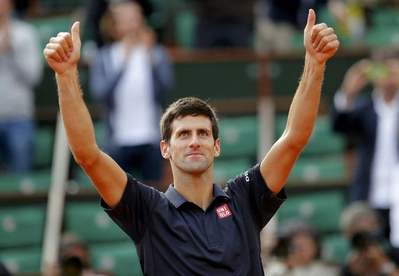 Novak Djokovic of Serbia celebrates after winning his men's quarter-final match against Milos Raonic of Canada at the French Open tennis tournament at the Roland Garros stadium in Paris June 3, 2014. REUTERS/Stephane Mahe