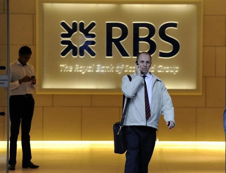A man walks out of an RBS building, in the City of London September 2, 2010.     REUTERS/Paul Hackett