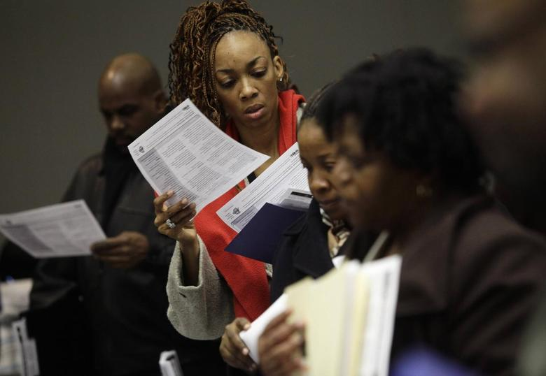 People attend a job fair in Detroit, Michigan in this March 1, 2014 file photo. REUTERS/Joshua Lott