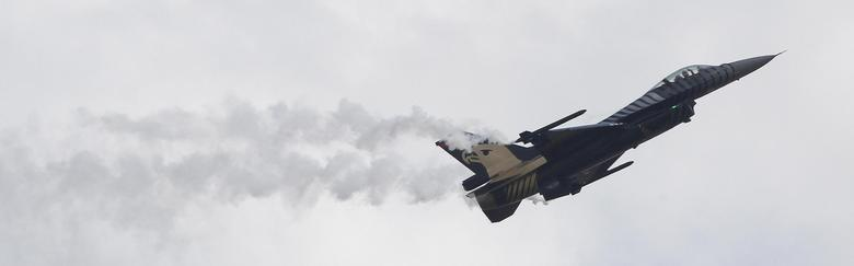 A Lockheed Martin F-16 of the Turkish Air Force performs during an acceptance flight at the upcoming ILA Berlin Air Show in Selchow near Schoenefeld south of Berlin May 19, 2014.. REUTERS/Tobias Schwarz