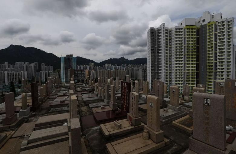 Headstones stand at a cemetery surrounded by residential flats in downtown Hong Kong May 29, 2014. REUTERS/Bobby Yip/Files